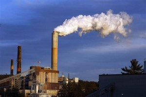 In this Jan. 20, 2015 file photo, a plume of steam billows from the coal-fired Merrimack Station in Bow, N.H. President Barack Obama on Monday, Aug. 3, 2015, will unveil the final version of his unprecedented regulations clamping down on carbon dioxide emissions from existing U.S. power plants. The Obama administration first proposed the rule last year. Opponents plan to sue immediately to stop the rule's implementation.  Jim Cole, File  - AP Photo Credit