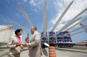 In this July 25, 2016 file photo, Rhode Island Gov. Gina Raimondo, left, speaks with Deepwater Wind CEO Jeffery Grybowski while touring a staging site at Port of Providence,. Steven Senne, File AP Photo)